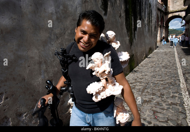A man sells religious souvenirs to tourists in Taxco de Alarcon, Guerrero State, Mexico, August 20, 2007. Photo/Chico - Stock Image