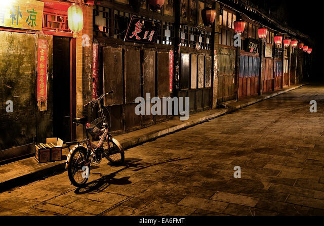 China, Pingyao, Street along the Pinyao market at night time - Stock Image