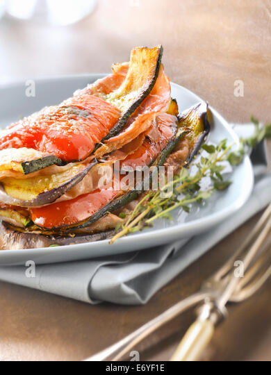 Grilled and layered vegetables and Parma ham - Stock Image