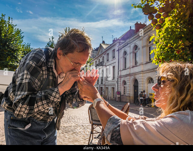 Woman lighting man's cigarette - France. - Stock Image