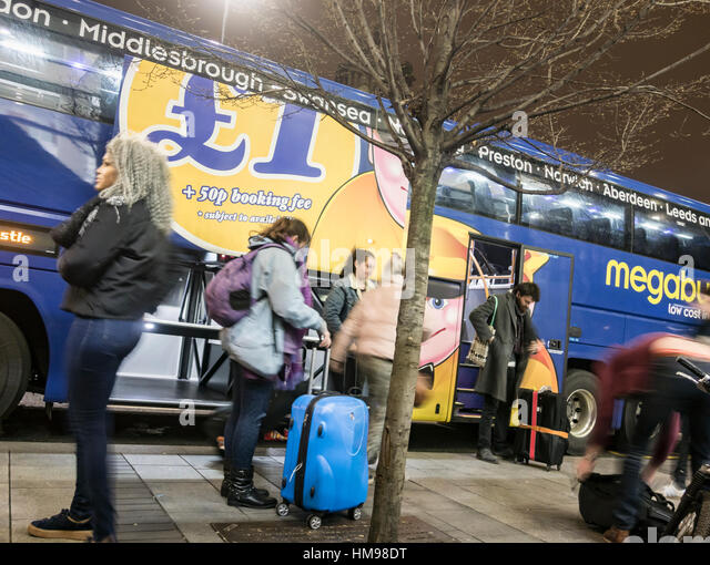 Megabus, which offers fares for as little as £1, at drop off and pick up point in Newcastle Upon Tyne, England. - Stock-Bilder