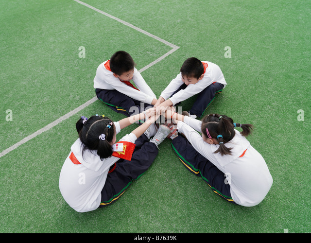 School children stretching during a physical fitness class. - Stock Image