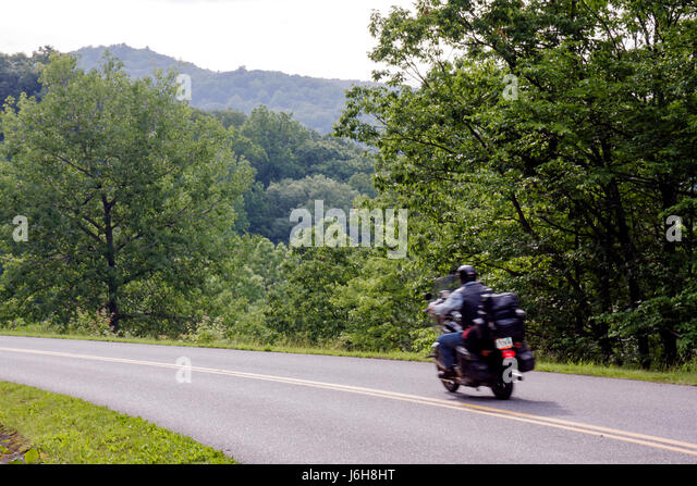 Virginia Appalachian Mountains Blue Ridge Parkway All-American Road National Scenic Byway scenery trees yellow lines - Stock Image