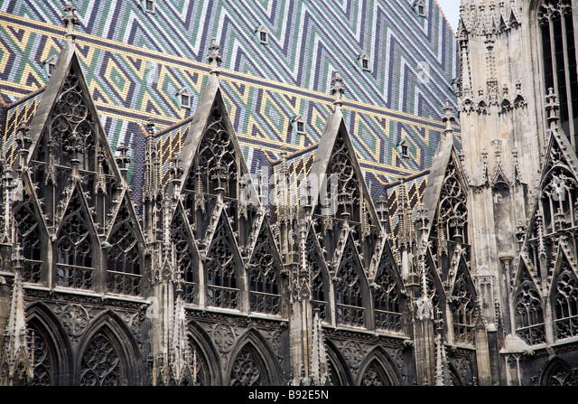 The multi coloured geometric roof and Gothic lacework of St Stephens Cathedral Stephansdom in the centre of Vienna - Stock Image