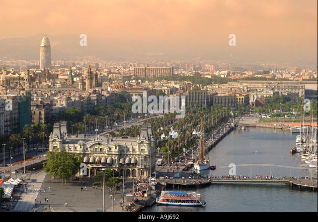 ESP Spain Barcelona harbour Barceloneta skyline teleshot Moll de la fusta Torre Agbar in background - Stock Image