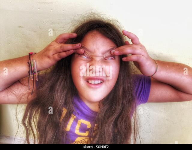 Children grimace, portrait - Stock Image