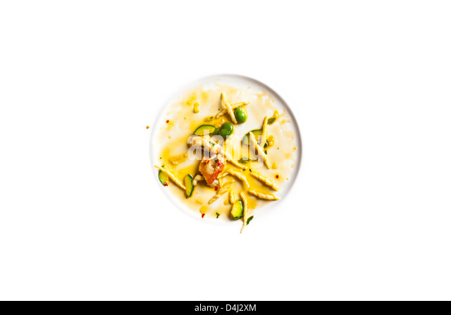 Trofie with lobster, zucchini and fava beans. - Stock Image