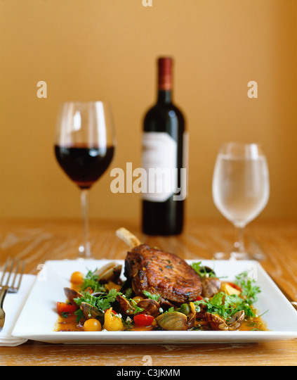 Pork chops with seafood and wine. - Stock Image