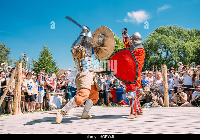 Dudutki, Belarus - July19, 2014: Historical restoration of knightly fights on festival of medieval culture. Knights - Stock Image
