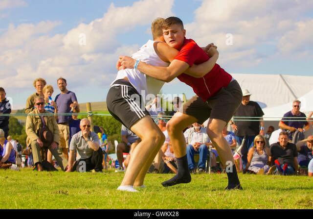 Young men Cumberland Wrestling. Bellingham Show and Country Festival, Bellingham, Northumberland, England, United - Stock Image