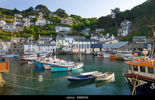 Fishing boats in Polperro Harbour, Polperro, Cornwall, England. Summer (June) 2010. - Stock Image