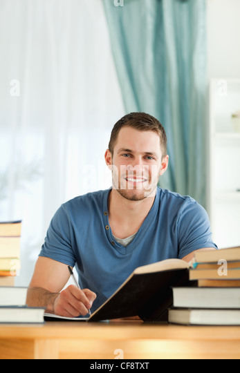 Student reviewing his subject material - Stock Image