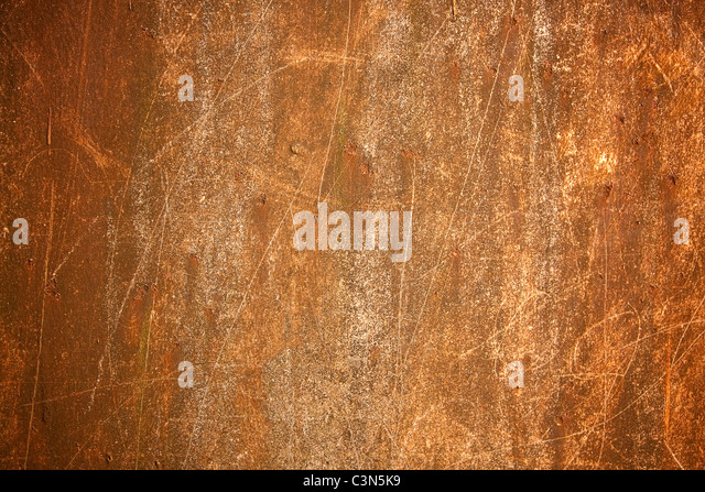 Photography shows a rusty metal background with scrachted surface. - Stock Image