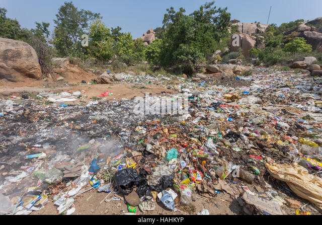 Rubbish strewn on open waste land near the town of Hampi, India - Stock Image