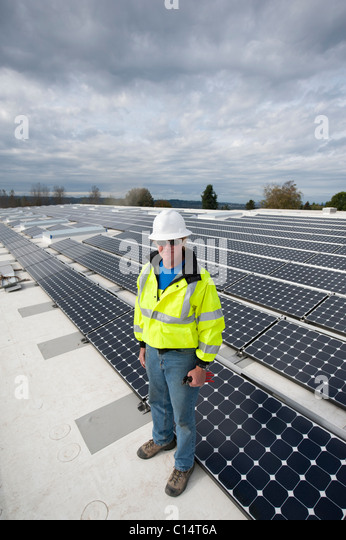 Portrait of a green energy business entrepreneur on a roof. - Stock Image