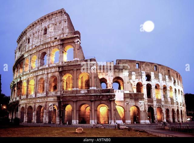 Rome Colloseum at dawn full moon - Stock Image