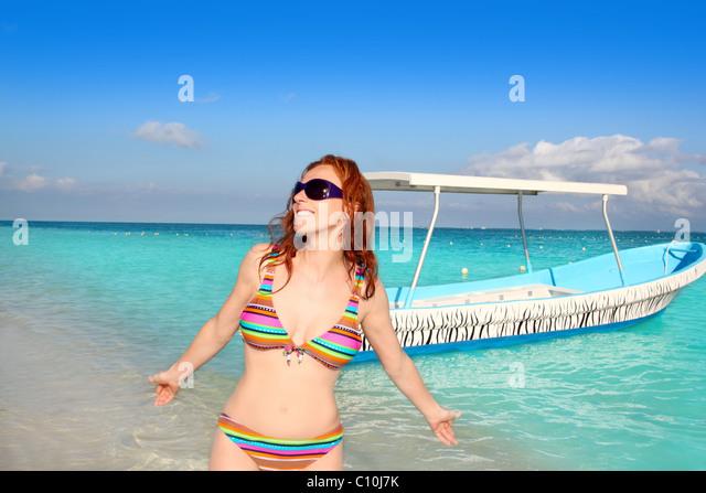 bikini medium age woman beach tourist in Caribbean tropical sea - Stock Image