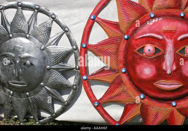 Florida, sun symbols, faces, red, metal, decorations, - Stock Image