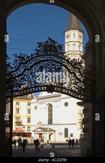 Vienna Hofburg wrought iron gate background Michaeler church - Stock Image