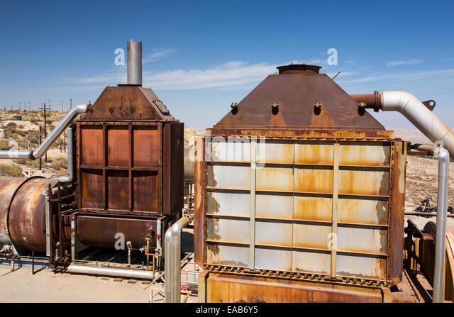 Steam equipment in the Midway Sunset oilfield near Taft, Bakersfield, California, USA. Following an unprecedented - Stock Image