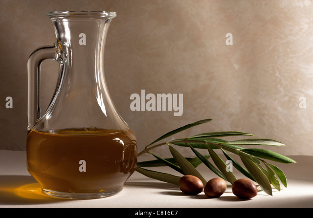 Oil Cruet with Olives and Branch - Stock-Bilder
