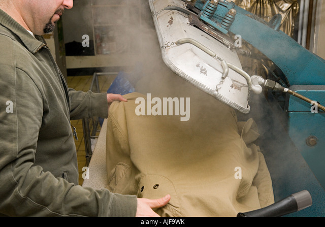 Man using trouser press - Stock Image
