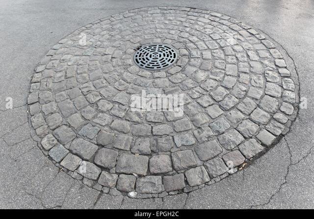 Manhole - Stock Image