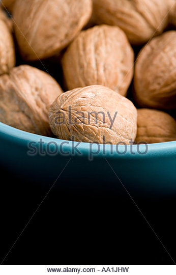 Walnuts in a bowl - Stock Image