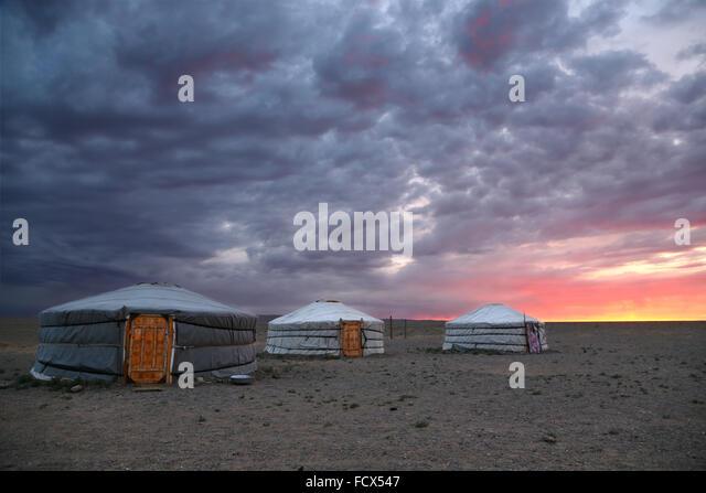Sunrise and traditional yurts in Gobi desert -  Mongolia - Stock Image