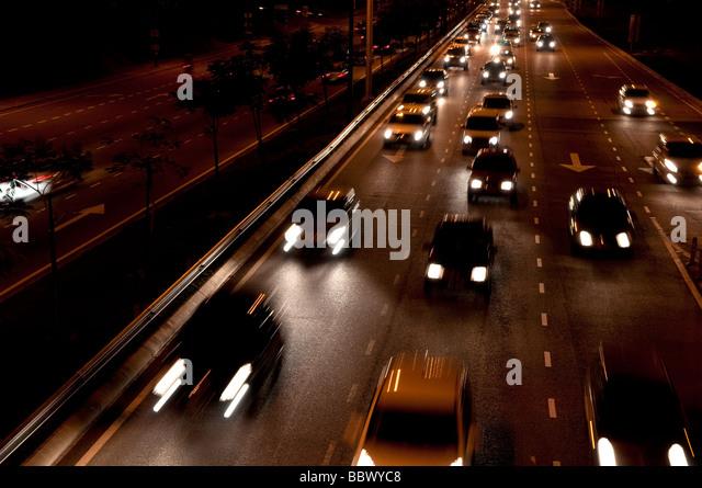 Cars moving on busy roads at night, Kuala Lumpur, Malaysia - Stock Image