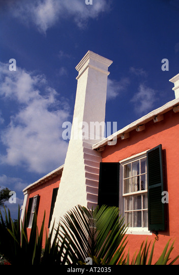 Bermuda pink building Classic Architecture white chimney blue sky background - Stock Image