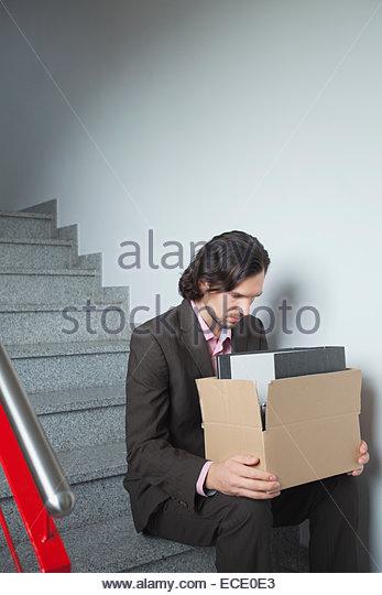 Man depressed sad unemployed alone worried - Stock Image