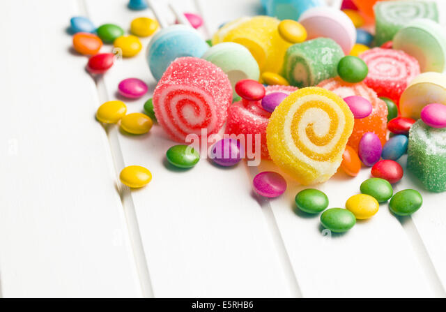 colorful candy on white table - Stock Image