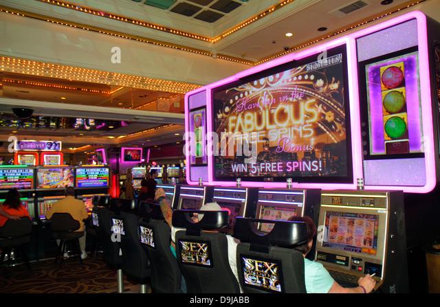 Nevada Las Vegas The Strip South Las Vegas Boulevard Flamingo Las Vegas Hotel and Casino gamblers gambling slot - Stock Image
