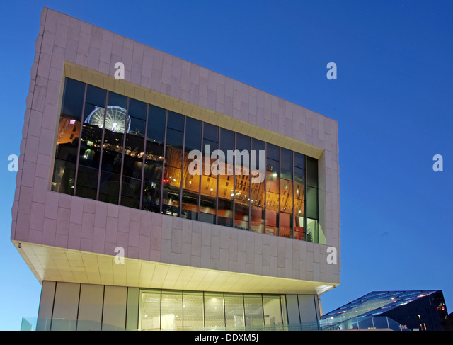 Albert Dock reflected in new museum at Nighttime liverpool Merseyside England UK - Stock Image