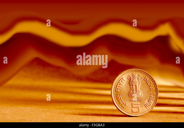 Indian currency five rupees coin and artistic background backside embossed Ashoka Pillar national symbols state - Stock-Bilder
