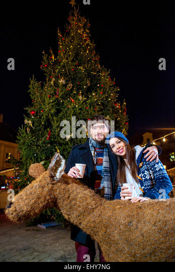 Happy young couple at Christmas Market - Stock-Bilder