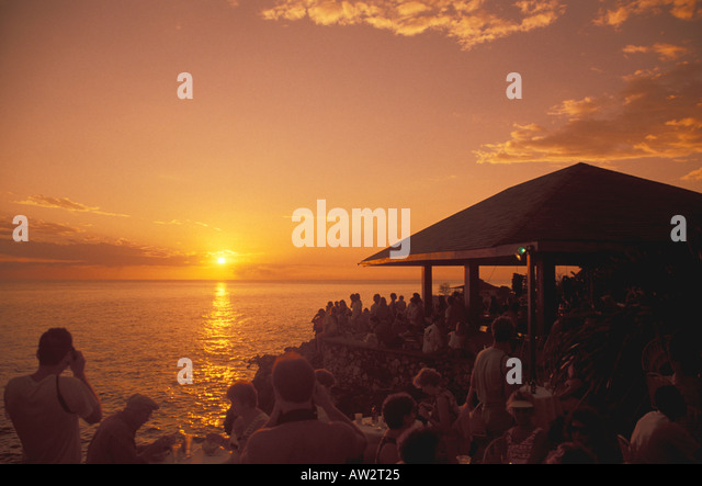 Jamaica Negril Sunset at Rick s Cafe, famous sunset celebration attraction. - Stock Image