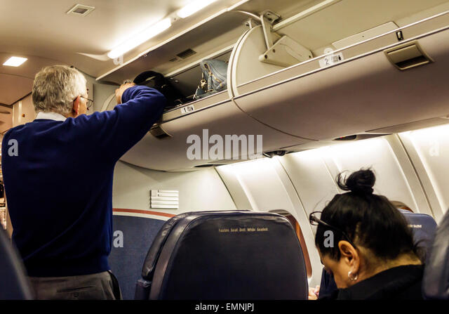 North Carolina Charlotte Charlotte Douglas International Airport CLT onboard cabin first class US Airways flight - Stock Image