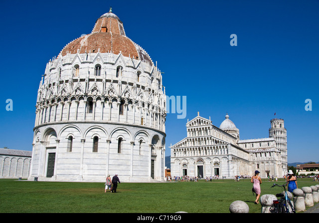The baptistry , cathedral and leaning tower ( campanile) in the field of miracles in Pisa Italy - Stock Image