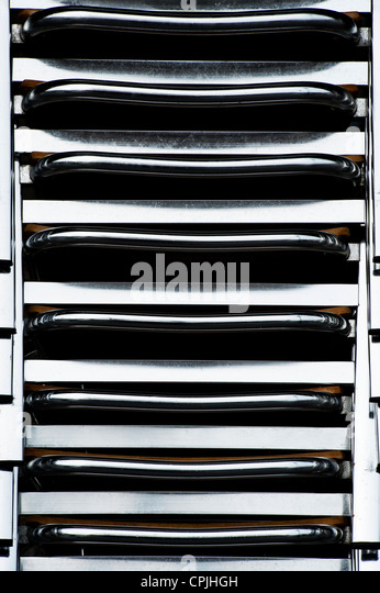 Chrome chair stack pattern - Stock Image