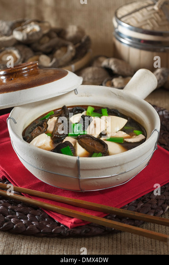 Clay pot chicken with mushrooms. Chinese food - Stock Image