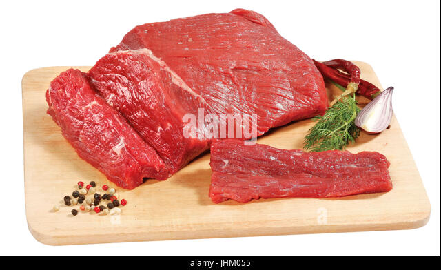 fresh raw red beef meat big steak chunk on wooden cut board isolated over white background - Stock Image