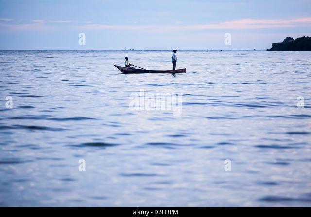 Two fisherman at sunset on Lake Victoria, Uganda - Stock Image