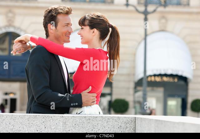 Romantic couple on a street, Paris, Ile-de-France, France - Stock Image