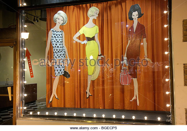 Georgia Savannah Historic District Broughton Street store window shop wood cutout fashion design 1960s sixties style - Stock Image