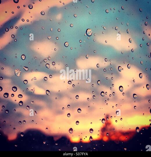 Candyfloss sunset through raindrops - Stock Image