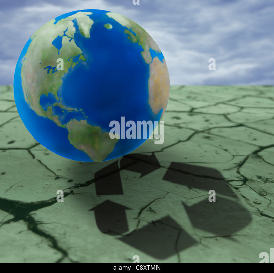 Earth on cracked ground with recycling sign, digital composite - Stock Image