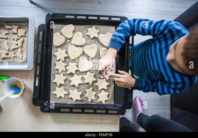 Young boy making cookies, overhead view - Stock Image