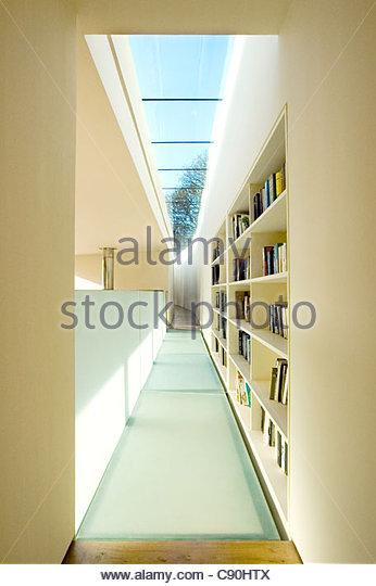 Bookshelves in hallway of modern house - Stock Image